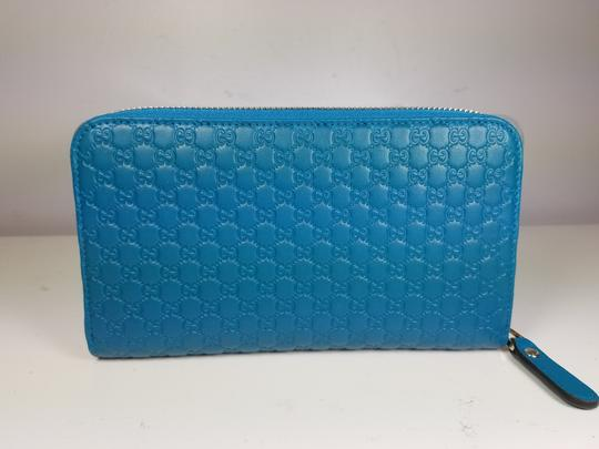 Gucci Women's 449391 Cobalt Leather Micro GG Guccissima Zip Around Wallet. Image 6