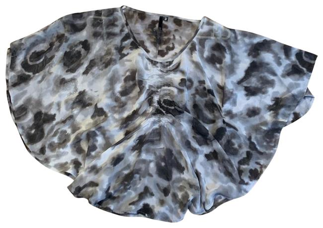 Item - XS Size In Black White and Grey Color. Swirly Design. Loose Fit As You Can See In Picture 2 Covers The So Top