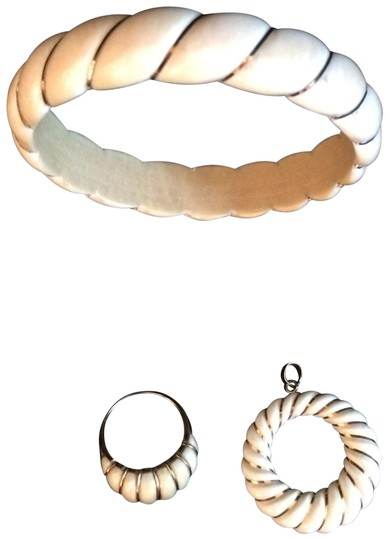 Preload https://img-static.tradesy.com/item/26039582/ivory-and-gold-wrapped-in-14k-3-pc-set-bracelet-0-7-540-540.jpg
