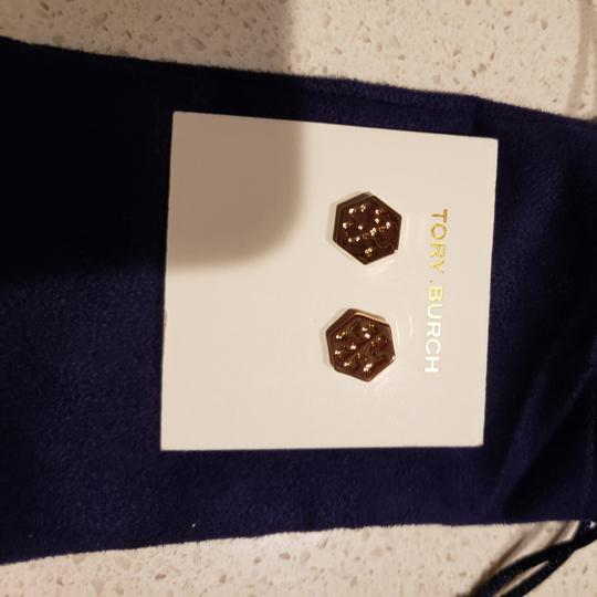 Preload https://item5.tradesy.com/images/tory-burch-rose-gold-stud-hexagon-logo-earrings-26039674-0-0.jpg?width=440&height=440