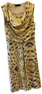 Multi print. Shades of yellow with shades of brown. Maxi Dress by Javier Simorra