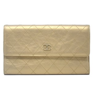 Chanel Chanel Tri Fold Gold Quilted Distressed Leather Wallet