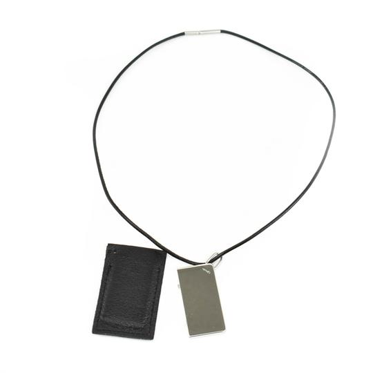 Preload https://img-static.tradesy.com/item/26055707/hermes-symbole-silver-metal-and-black-leather-logo-mt-necklace-0-0-540-540.jpg