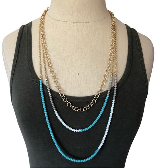Preload https://img-static.tradesy.com/item/26055954/gold-and-turquoise-3-layer-crystal-necklace-0-3-540-540.jpg