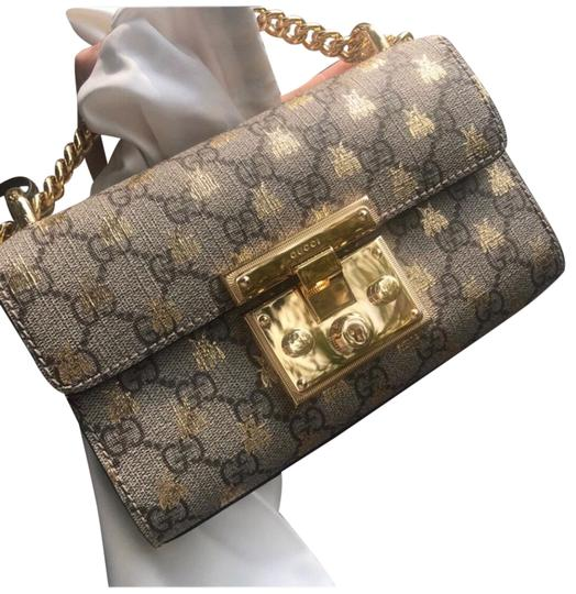 Preload https://img-static.tradesy.com/item/26058809/gucci-padlock-bee-light-brown-calfskin-leather-and-canvas-cross-body-bag-0-1-540-540.jpg