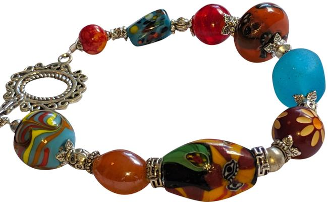 Item - Red Silver Blue Yellow Glass Beaded Tone Bracelet