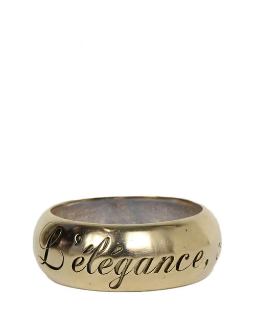"Item - Gold L 2007 Goldtone ""L'elegance C'est La Linge"" Bangle Bracelet"