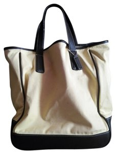 Coach Tote in light yellow.. black leather trim