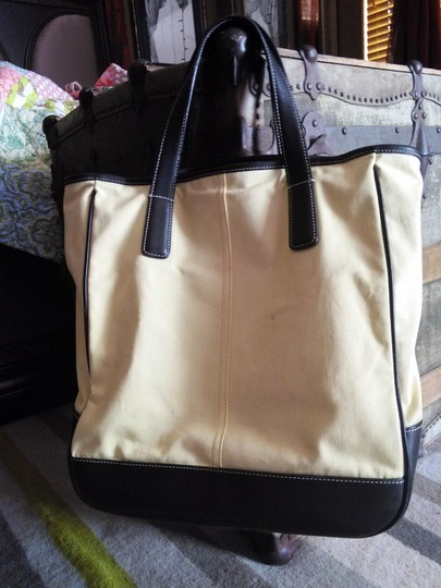 Coach Tote in light yellow.. black leather trim Image 1