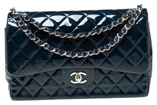 Preload https://img-static.tradesy.com/item/26116058/chanel-classic-flap-quilted-jumbo-classic-double-blue-patent-leather-shoulder-bag-0-1-540-540.jpg