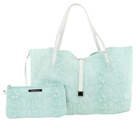 Preload https://img-static.tradesy.com/item/26118011/tiffany-and-co-reversible-large-with-matching-wristlet-blue-suede-leather-tote-0-2-540-540.jpg