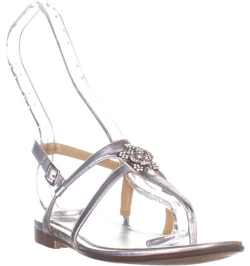 Preload https://img-static.tradesy.com/item/26118397/naturalizer-silver-w-tilly-flat-slingback-metallic-sandals-size-us-65-wide-c-d-0-1-540-540.jpg