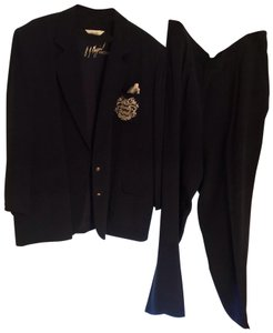 Peter Nygard light weight nautical inspired suit. 2 button blazer, large gold insignia on the breast pkt, with pkt square. 2 pleat front pants, side button enter and closure. not lined, light weight fabric
