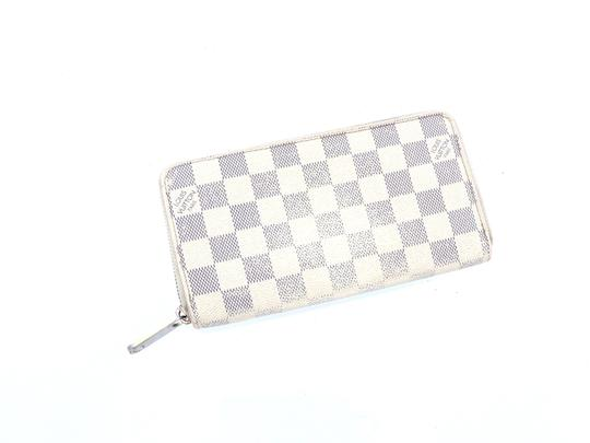 Preload https://img-static.tradesy.com/item/26130965/louis-vuitton-white-long-clutch-zippy-damier-azur-canvas-leather-zip-wallet-0-0-540-540.jpg