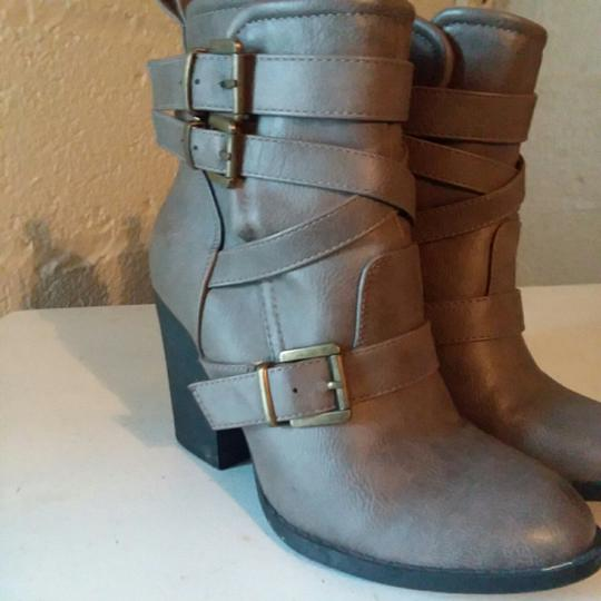 Preload https://item4.tradesy.com/images/justfab-taupe-belted-bootsbooties-size-us-55-narrow-aa-n-26130998-0-1.jpg?width=440&height=440