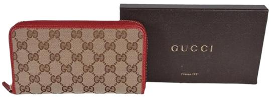 Preload https://img-static.tradesy.com/item/26131104/gucci-red-clutch-363423-beige-gg-guccissima-canvas-zip-around-wallet-0-3-540-540.jpg