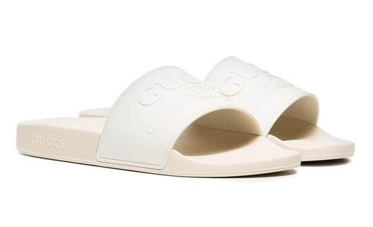 Preload https://img-static.tradesy.com/item/26131255/gucci-white-logo-embossed-rubber-slide-mule-slipper-flat-pool-flip-flop-sandals-size-eu-35-approx-us-0-0-540-540.jpg