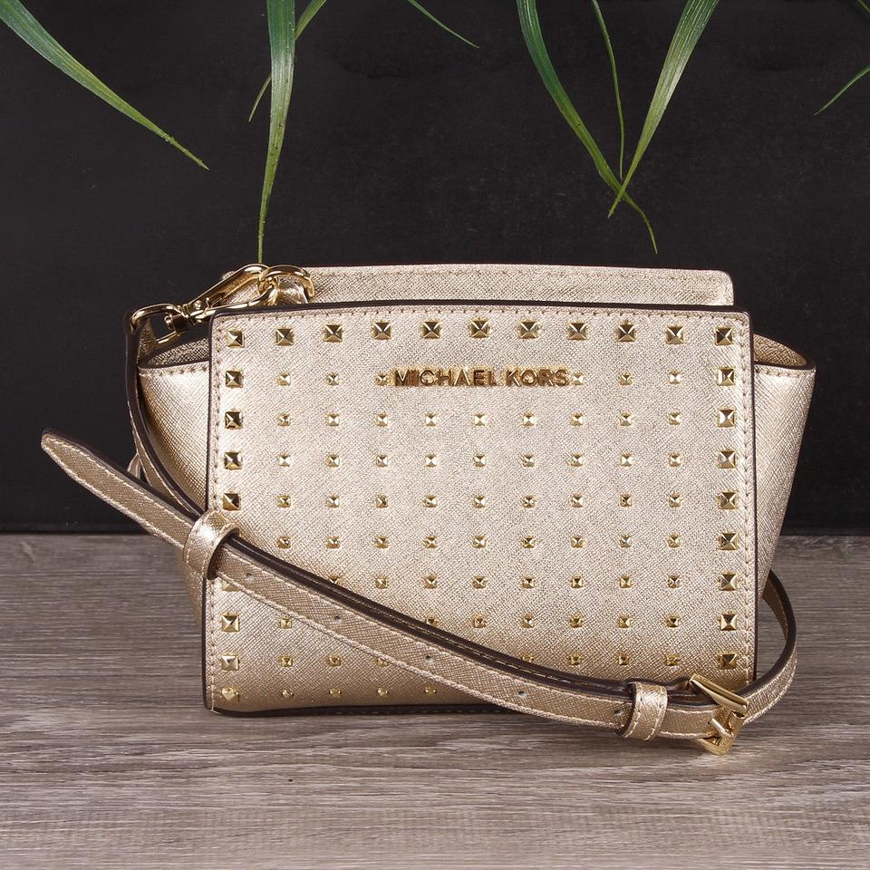 791fef6 michael kors selma stud mini leather pale gold