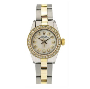Rolex Rolex Oyster Perpetual 67193 24MM White Diamond Dial With 0.90 CT