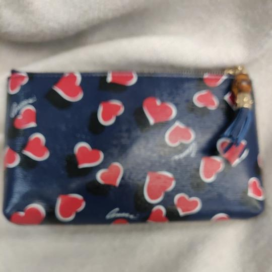 Preload https://item3.tradesy.com/images/gucci-heartbeat-blue-black-and-red-leather-wristlet-26150032-0-0.jpg?width=440&height=440