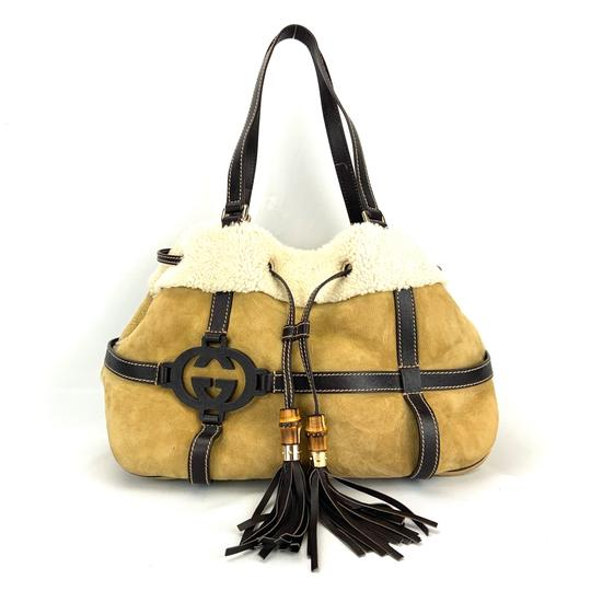 Preload https://img-static.tradesy.com/item/26155959/gucci-tote-shearling-royal-beige-and-brown-suede-leather-shoulder-bag-0-1-540-540.jpg