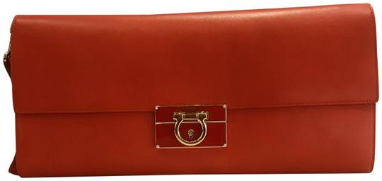 Preload https://img-static.tradesy.com/item/26155975/salvatore-ferragamo-afef-gancio-tomato-red-lambskin-leather-clutch-0-2-540-540.jpg