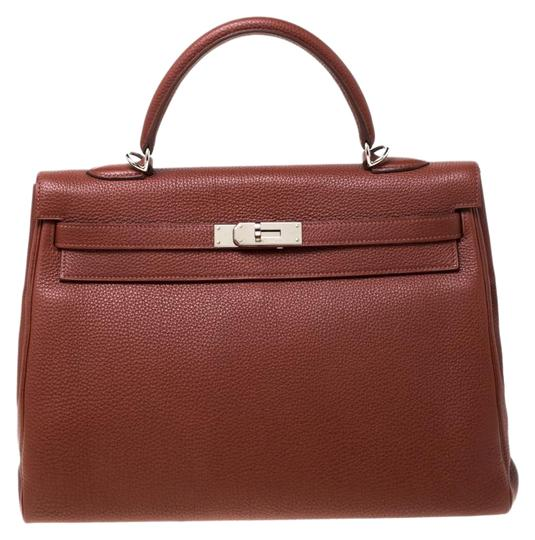 Preload https://img-static.tradesy.com/item/26156163/hermes-kelly-sienne-palladium-hardware-retourne-35-tan-leather-tote-0-1-540-540.jpg