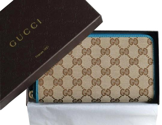 Preload https://img-static.tradesy.com/item/26156201/gucci-teal-brown-clutch-new-women-s-gg-guccissima-canvas-zip-around-wallet-0-3-540-540.jpg