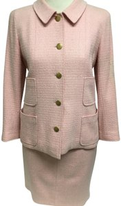 Chanel Pink tweed skirt suit with gold logo buttons