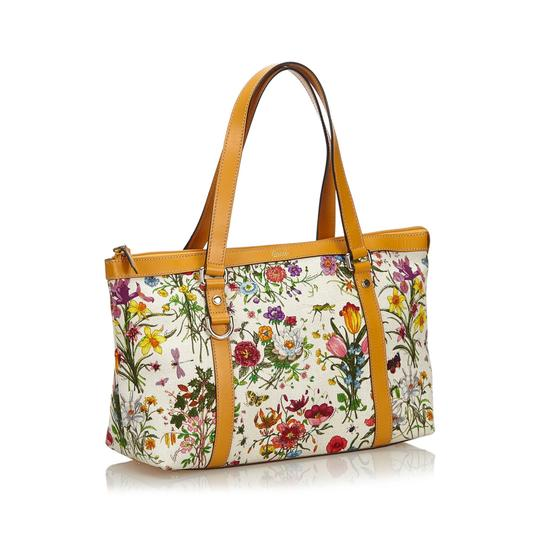Preload https://img-static.tradesy.com/item/26161695/gucci-abbey-bag-ivory-with-multi-canvas-fabric-italy-white-leather-tote-0-0-540-540.jpg