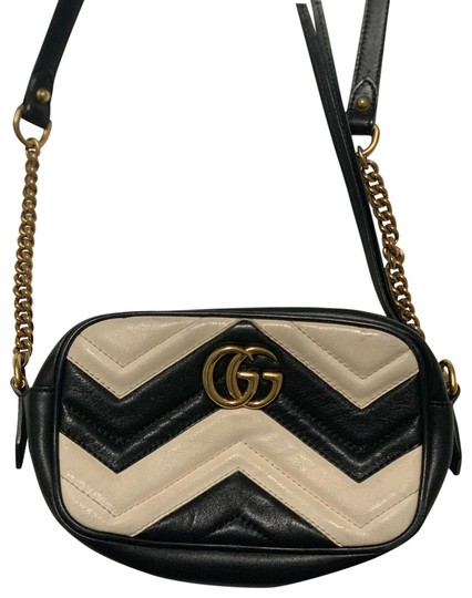 Preload https://img-static.tradesy.com/item/26161743/gucci-marmont-gg-mini-calfskin-leather-black-and-white-cross-body-bag-0-1-540-540.jpg