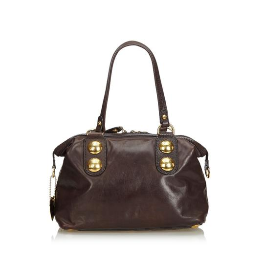 Preload https://img-static.tradesy.com/item/26161924/gucci-w-dark-with-gold-others-italy-w-dust-brown-leather-shoulder-bag-0-0-540-540.jpg
