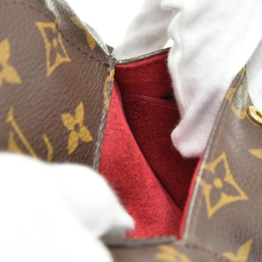 Louis Vuitton Wristlet in Brown Image 7
