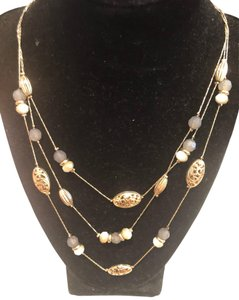 New York & Company gold layered necklace with blue accent