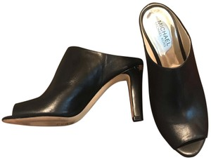 MICHAEL Michael Kors Black with silver logo plate Mules