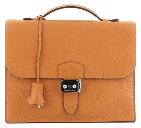 Preload https://img-static.tradesy.com/item/26173811/hermes-sac-a-depeches-clemence-27-orange-leather-weekendtravel-bag-0-2-540-540.jpg