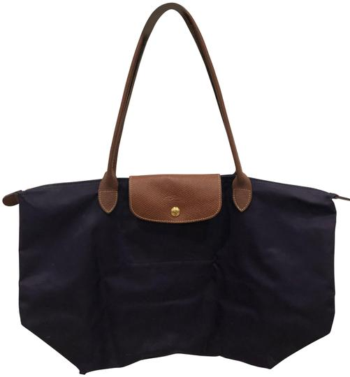 Preload https://img-static.tradesy.com/item/26183259/longchamp-le-pliage-purple-nylon-leather-tote-0-1-540-540.jpg