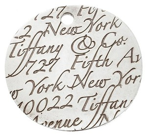 Tiffany & Co. Notes Fifth Avenue New York Engraved Circular Silver Pendant Charm