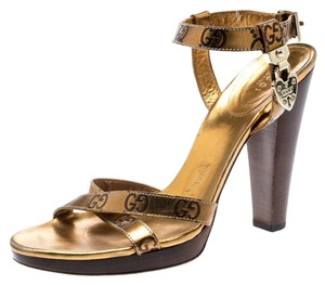 Gucci Metallic Leather Ankle Strap Gold Sandals