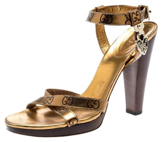 Preload https://img-static.tradesy.com/item/26198156/gucci-gold-guccissima-cross-ankle-strap-lock-detail-open-sandals-size-eu-385-approx-us-85-regular-m-0-1-540-540.jpg