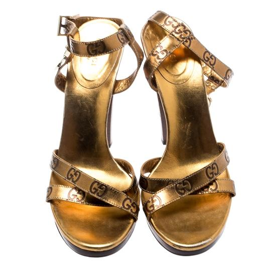 Gucci Metallic Leather Ankle Strap Gold Sandals Image 1