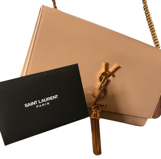 Preload https://img-static.tradesy.com/item/26198562/saint-laurent-nude-with-gold-detialing-leather-cross-body-bag-0-1-540-540.jpg