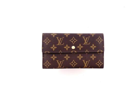 Preload https://img-static.tradesy.com/item/26206873/louis-vuitton-brown-clutch-international-monogram-canvas-leather-long-wallet-0-0-540-540.jpg