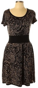 Gabby Skye short dress Black & Tan Sweaterdress Fit And Flare Snake Print Knit on Tradesy