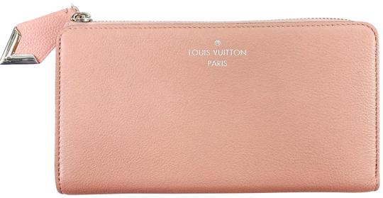 Preload https://img-static.tradesy.com/item/26214155/louis-vuitton-magnolia-zippy-2015-taurillon-leather-comete-wallet-0-1-540-540.jpg