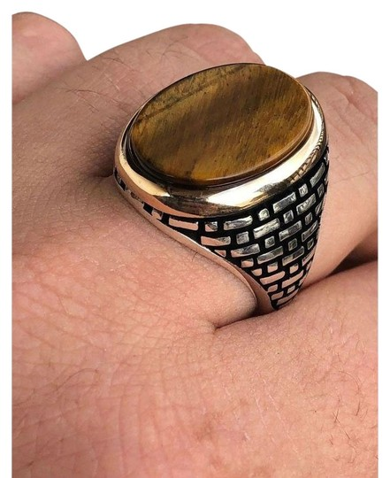 Preload https://img-static.tradesy.com/item/26229589/solid-10k-gold-and-925-sterling-silver-tiger-s-eye-ring-0-1-540-540.jpg