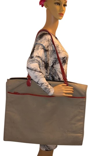 Preload https://img-static.tradesy.com/item/26229898/kate-spade-canvas-and-leather-garment-tote-0-1-540-540.jpg