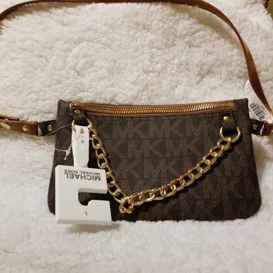 Michael Kors Wristlet in Brown with mk Image 1