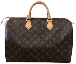 Louis Vuitton Satchel in black and brown