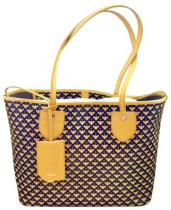 Bally Tote in mustard with black and purple print on the canvas